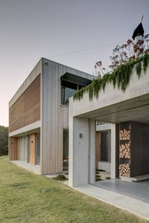 A two-story, timber volume holds the private areas while a one-story concrete pavilion is more social and communal. Large openings blend indoor and outdoor spaces while allowing coastal breezes to become part of the home environment.