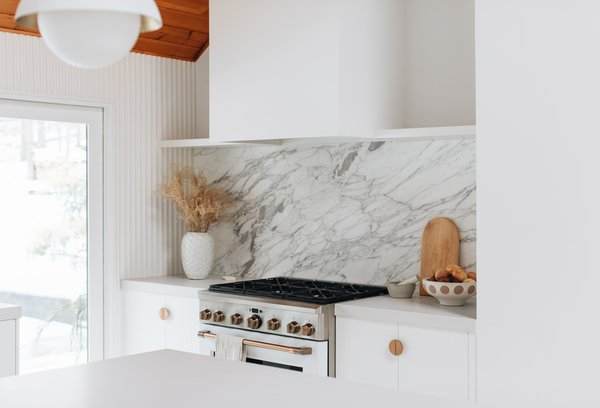 Sarah worked with Cafe Appliances to bring her vision to life. The matte white appliances blend in with the rest of the home and the warm bronze appliance hardware adds just the right metallic accent.