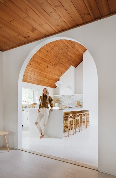 The entrance from the dining room to the kitchen was opened up considerably with an arched expression, creating a much better flow and unifying the two spaces.