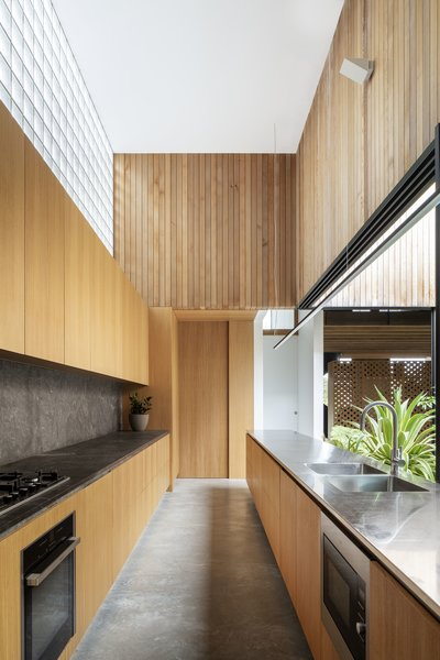 Glass blocks allow soft light to enter the kitchen without distracting from the courtyard view.
