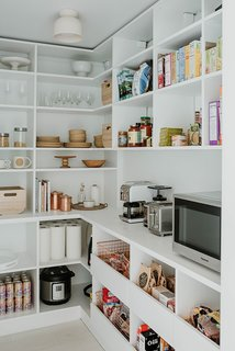 The large pantry allows all the food to be in one place, visually out of the way, yet still super convenient to the rest of the kitchen.