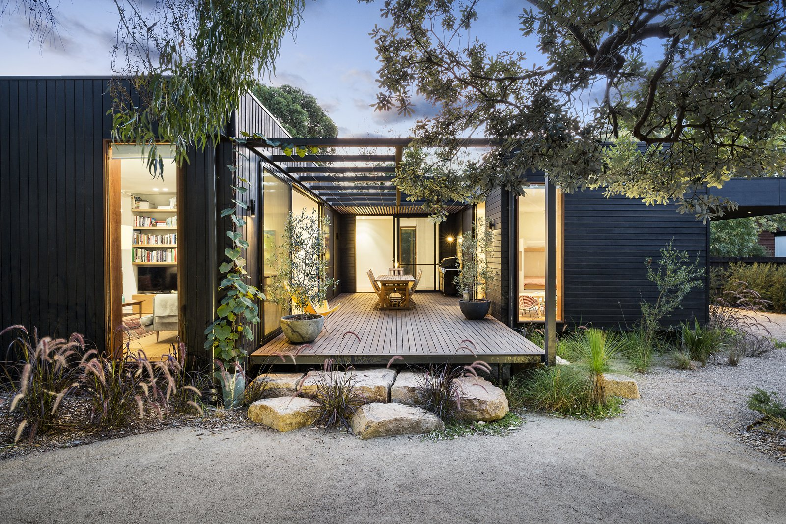 Garden, Shrubs, Side Yard, Trees, Grass, Wood, Boulders, Walkways, Large, Metal, Decking, Exterior, House, and Wood Architect: Pleysier Perkins, Location: Merricks Beach, Victoria, Australia  Best Exterior Metal Wood Photos from The Merricks Beach House