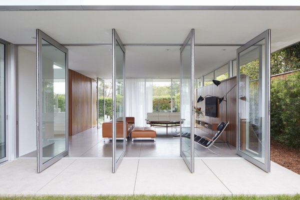 Floor to ceiling glass doors pivot onto the back patio.