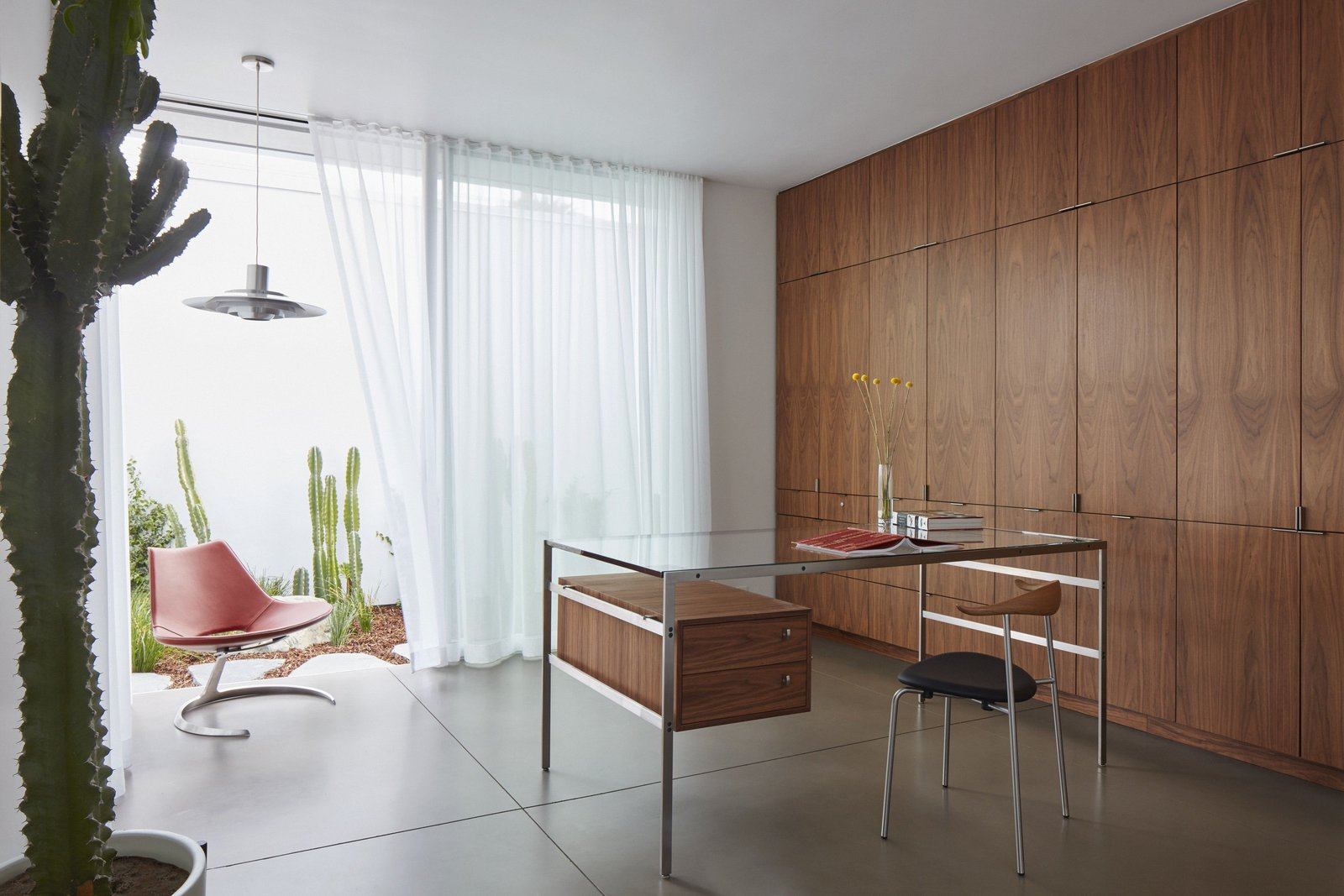 Office, Study Room Type, Chair, Desk, Concrete Floor, Lamps, and Storage In 2015 the Fabricius & Kastholm desk bo-555 was manufactured for the Santa Monica Residence. Before that, it hadn't been manufactured for more than two decades.  Santa Monica Residence