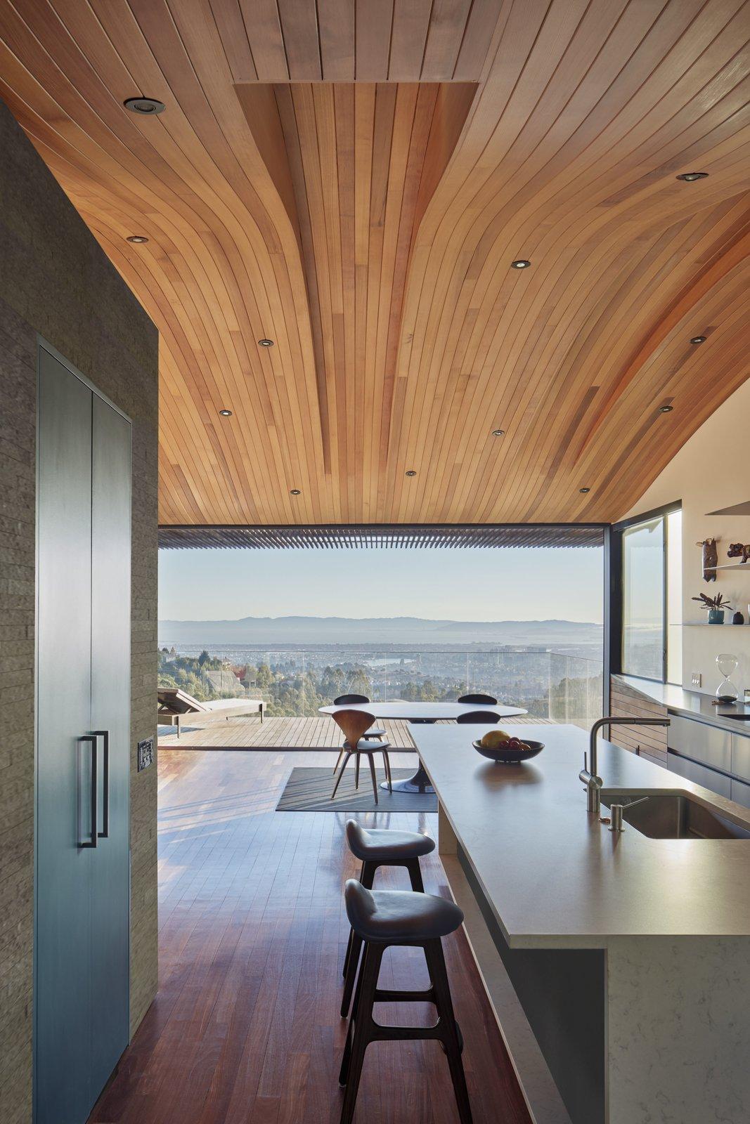 Kitchen, Engineered Quartz Counter, Laminate Cabinet, Medium Hardwood Floor, Undermount Sink, and Recessed Lighting Detail of kitchen  Skyline House by Terry & Terry Architecture