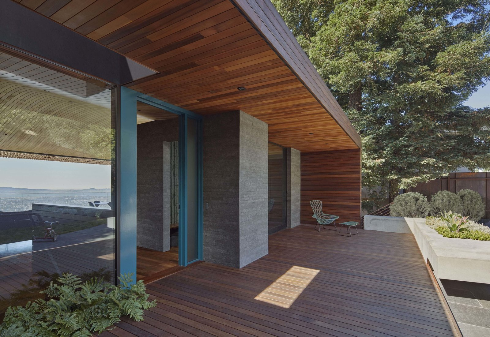 Outdoor, Front Yard, Grass, Shrubs, Hardscapes, Small Patio, Porch, Deck, Wood Patio, Porch, Deck, Metal Fences, Wall, and Landscape Lighting Entry porch  Skyline House by Terry & Terry Architecture