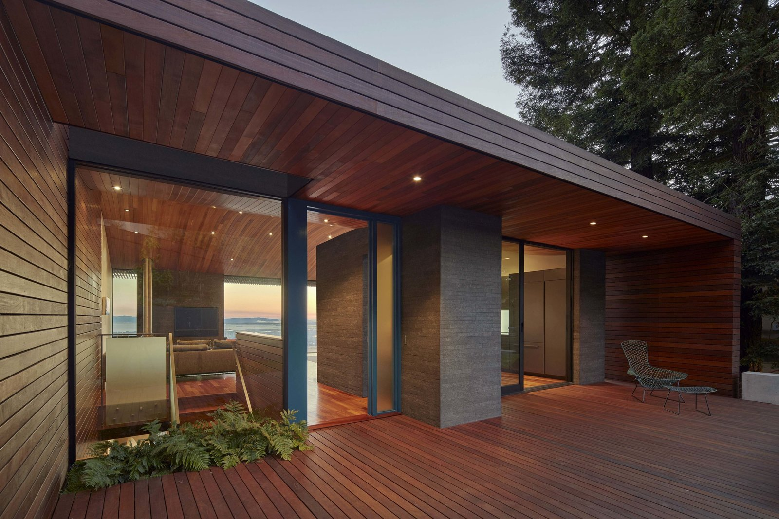 Outdoor, Front Yard, Shrubs, Small Patio, Porch, Deck, and Wood Patio, Porch, Deck Entry at dusk  Skyline House by Terry & Terry Architecture