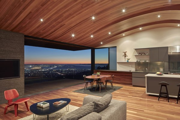 Living, Chair, Coffee Tables, Stools, Table, Rug, Shelves, Bar, Recessed, Sectional, and Medium Hardwood Common space  Best Living Bar Recessed Photos from Skyline House