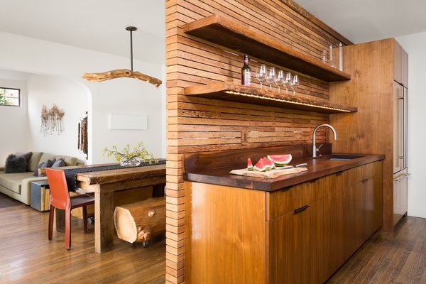 Kitchen with view of Dining and Living Room beyond.  Pendant light fixture by Chris McCullough
