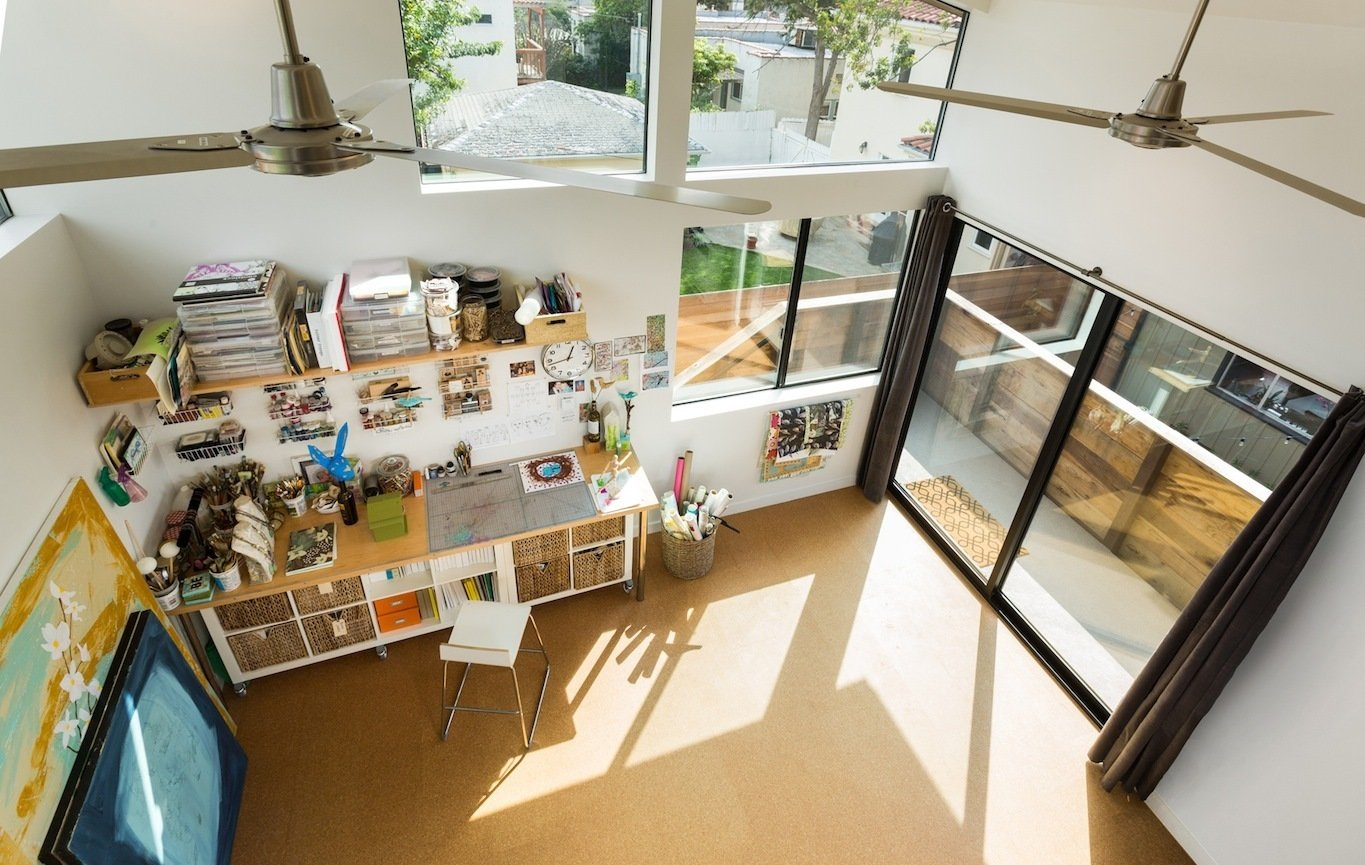 Craft Room Room Type, Bookcase, Storage, Desk, Shelves, Chair, Cork Floor, Track Lighting, Sliding Window Type, Doors, Metal, Picture Window Type, Exterior, and Sliding Door Type View from the book loft mezzanine.  Floors are cork tile  Mar Vista Art Studio by Hsu McCullough