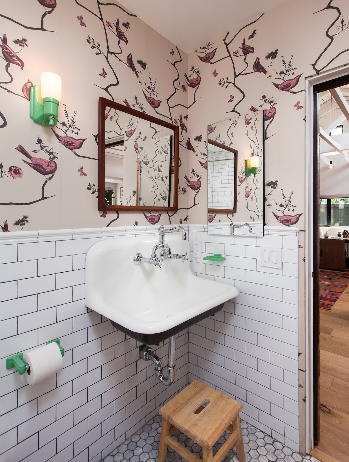 Kid's Bathroom with playful wallpaper, subway tile and colorful bathroom accessories Tagged: Marble Floor, Wall Mount Sink, Subway Tile Wall, and Bath Room.  Ashland Residence by Hsu McCullough