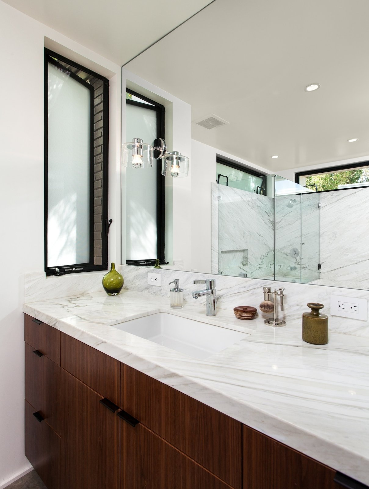 Marble Counter, Undermount Sink, Undermount Tub, Recessed Lighting, Marble Wall, Metal, Casement Window Type, and Bath Room Bathroom vanity with American Black Walnut cabinet and calacatta marble countertops and shower walls.  Ashland Residence by Hsu McCullough