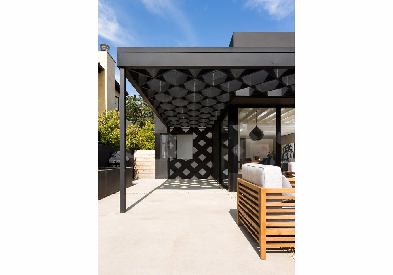 Outdoor, Hardscapes, Side Yard, Shrubs, Walkways, Wood, Concrete, Decomposed Granite, Horizontal, Wood, Landscape, and Planters Shadows of the pergola at rear yard patio  Outdoor Side Yard Concrete Wood Decomposed Granite Photos from Las Casas Residence