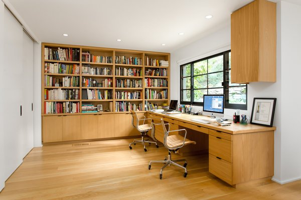 Study overlooks side yard ascending hillside