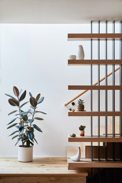 Stair detail with curios and plants.  White oak and steel.