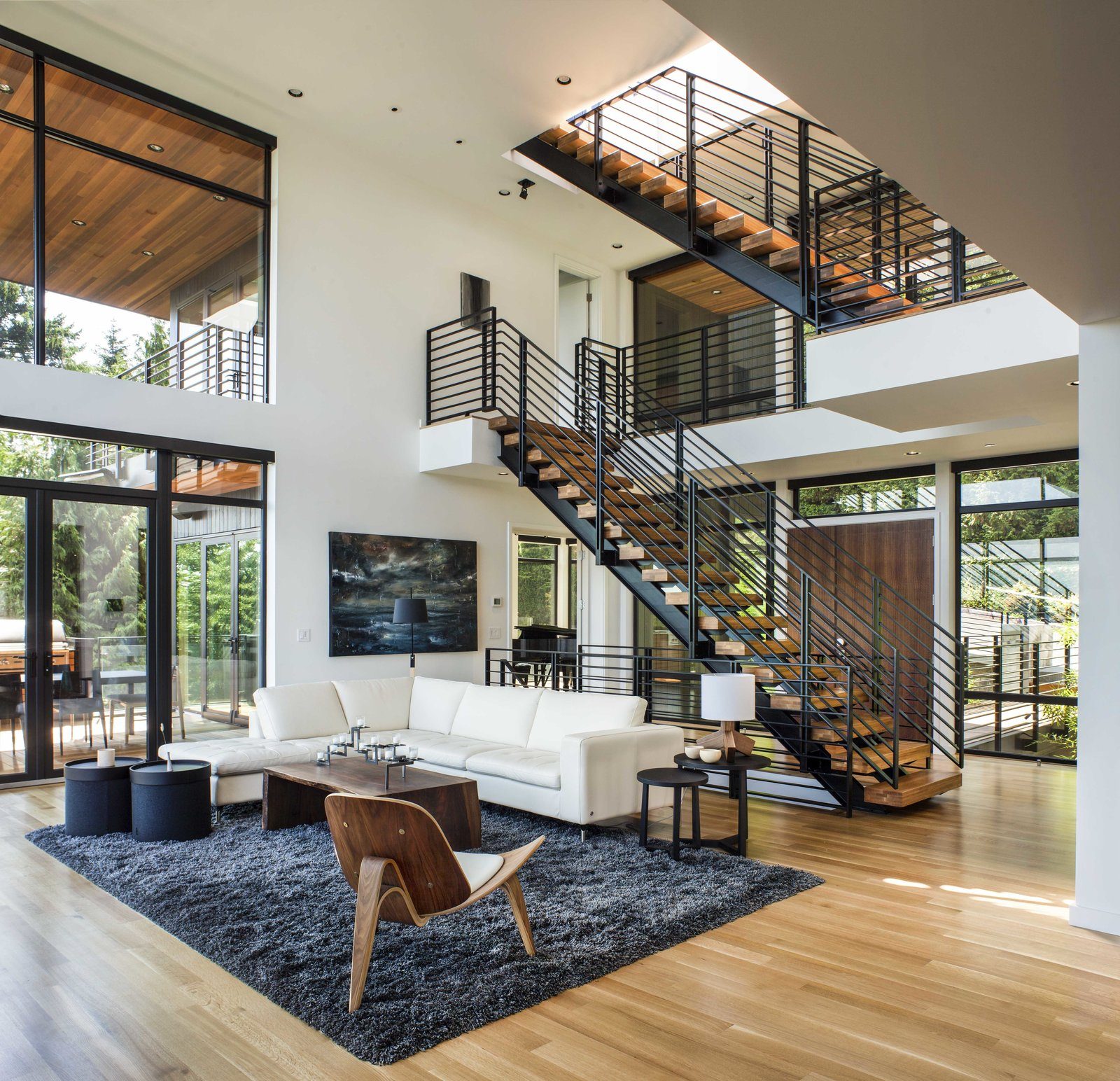 Living Room, Chair, Coffee Tables, End Tables, Medium Hardwood Floor, Lamps, Ceiling Lighting, Recessed Lighting, Rug Floor, and Sectional Interior  Music Box Residence by Scott | Edwards Architecture