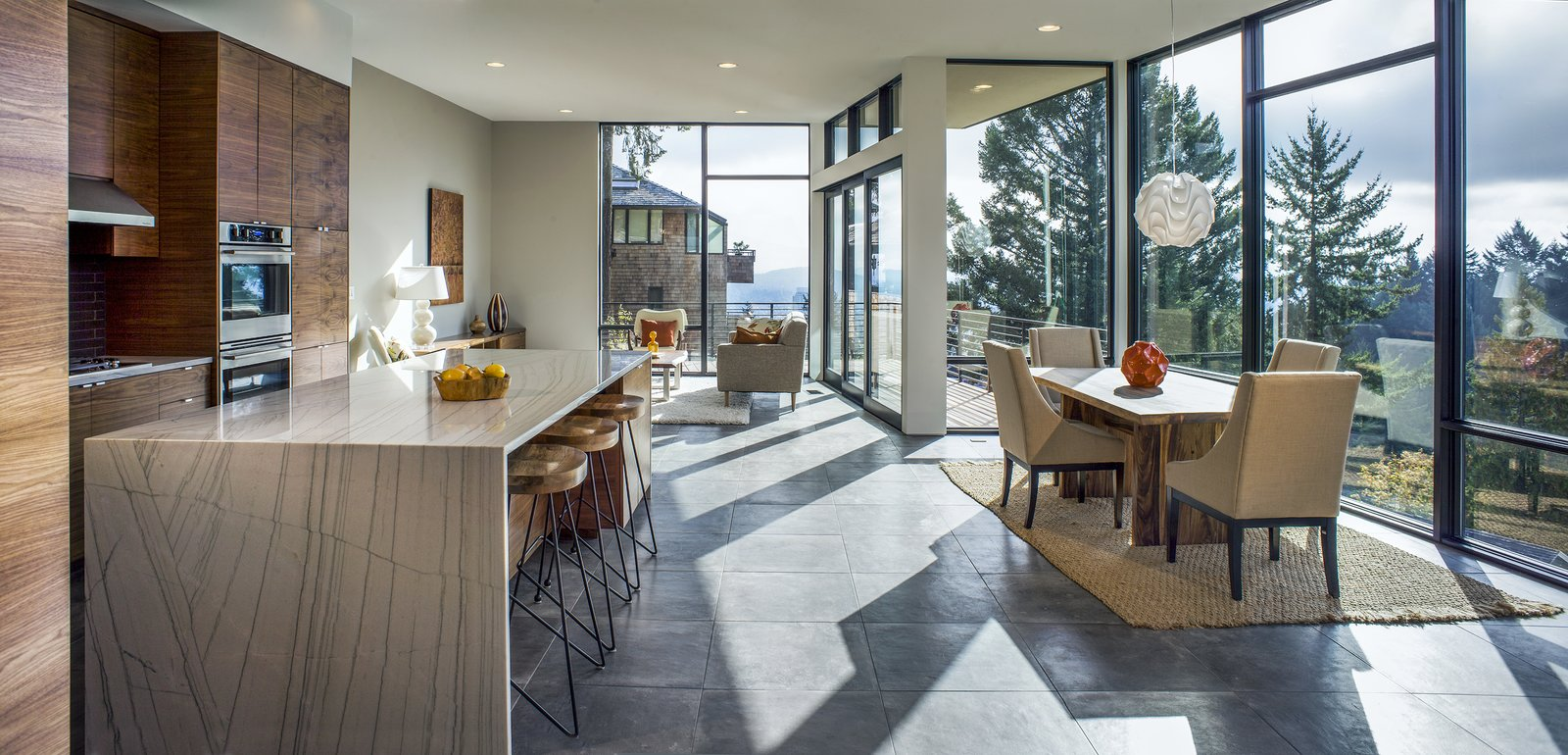 Wood Cabinet, Ceramic Tile Floor, Granite Counter, Ceramic Tile Backsplashe, Wall Oven, Ceiling Lighting, Cooktops, Range Hood, Range, Microwave, Chair, Sofa, Dining Room, Table, and Stools Kitchen/Living/Dining  Canterbury Residence by Scott | Edwards Architecture