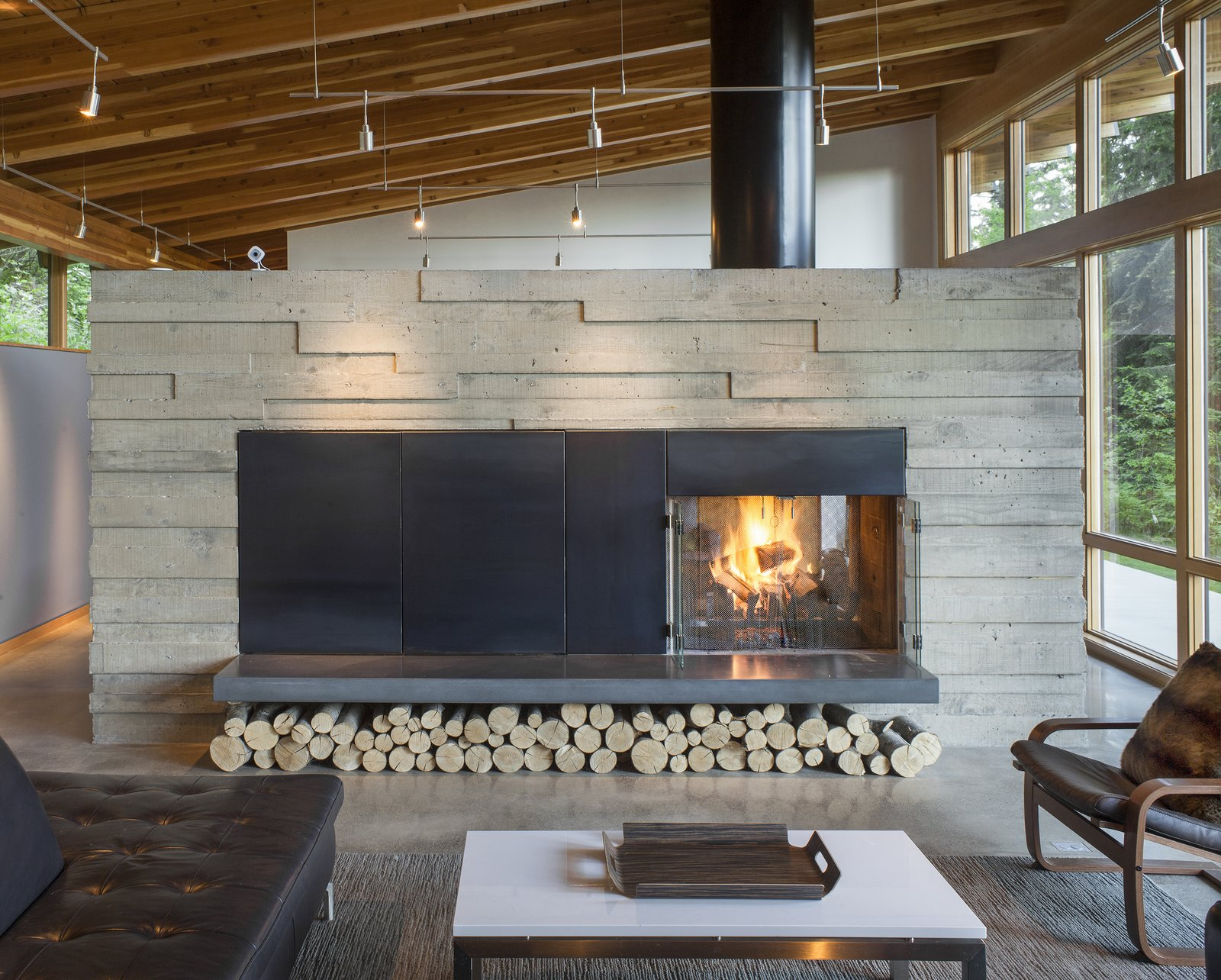 Living, Coffee Tables, Sofa, Concrete, Two-Sided, Rug, Pendant, Chair, and Wood Burning Fire Place  Best Living Two-Sided Concrete Photos from Brightwood Cabin