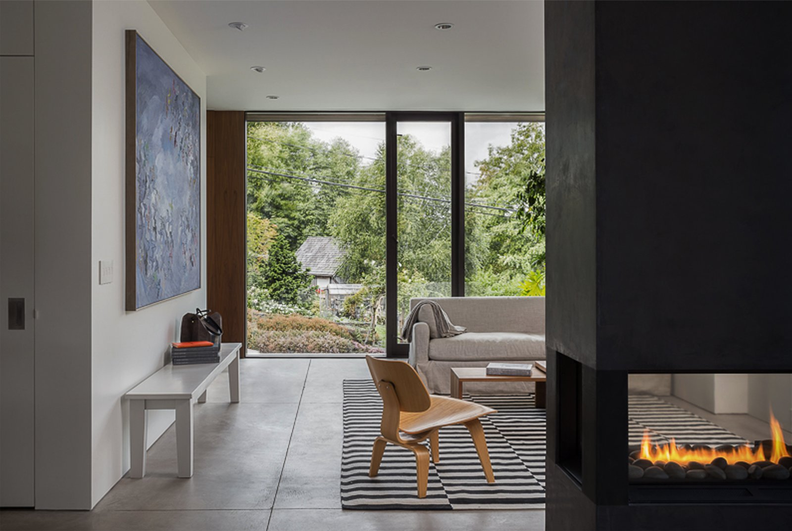 Living Room, Concrete Floor, and Two-Sided Fireplace Helen Street by mw|works  Helen Street by mw|works