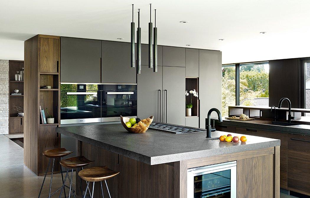 Kitchen, Concrete Counter, Wood Cabinet, Wine Cooler, Pendant Lighting, and Wall Oven Laurelhurst Residence  Quantum Clad Windows & Doors
