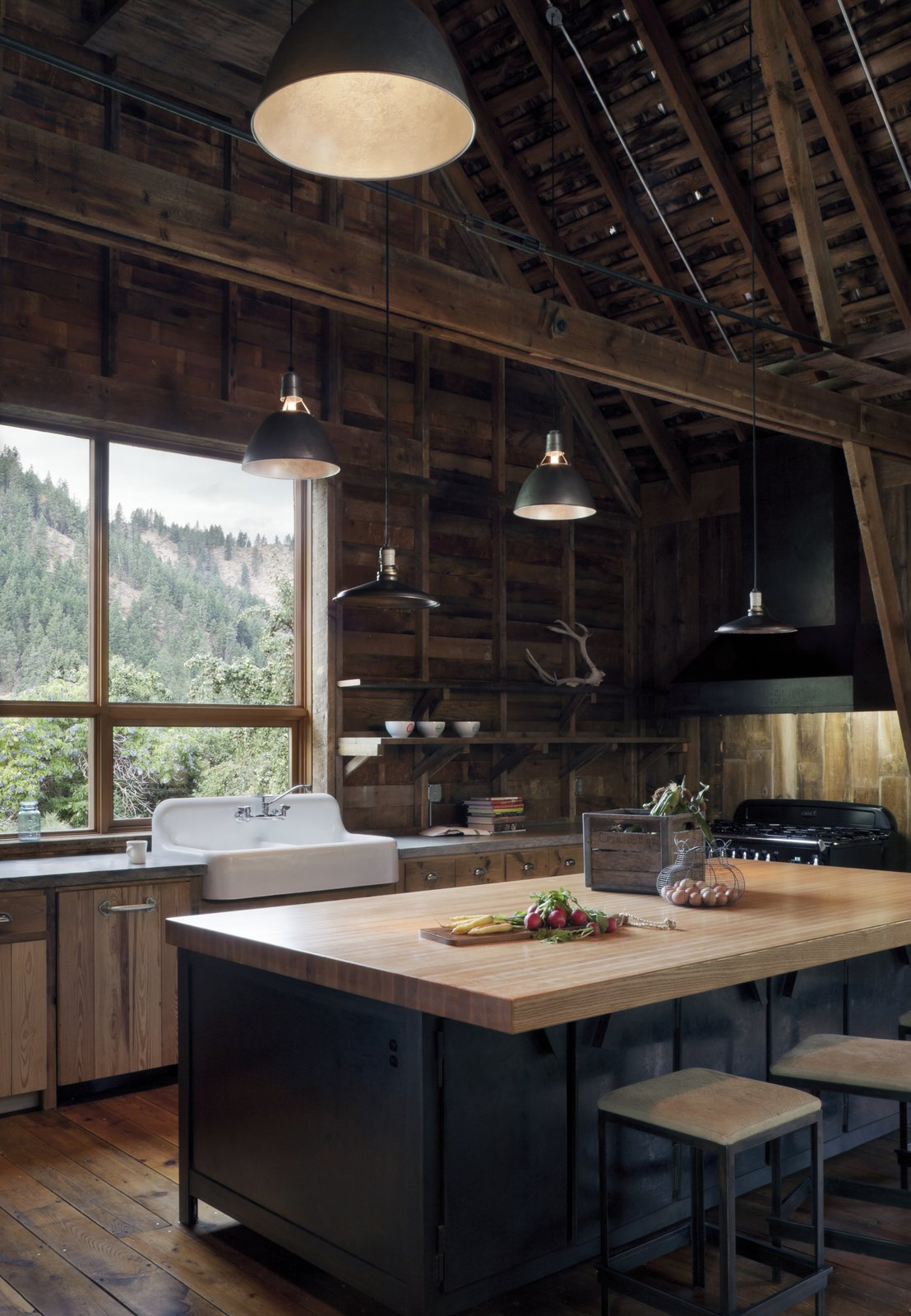 Kitchen, Wood Backsplashe, Medium Hardwood Floor, Wood Counter, Pendant Lighting, Drop In Sink, Range, and Vessel Sink Canyon Barn  Best Photos from c