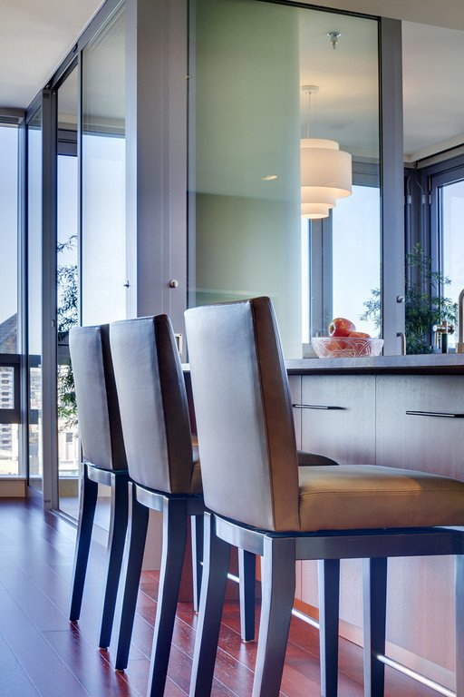 Dining Room, Stools, Bar, Medium Hardwood Floor, and Ceiling Lighting Stools from A.Rudin sit at the kitchen island.  Downsize Upstyle