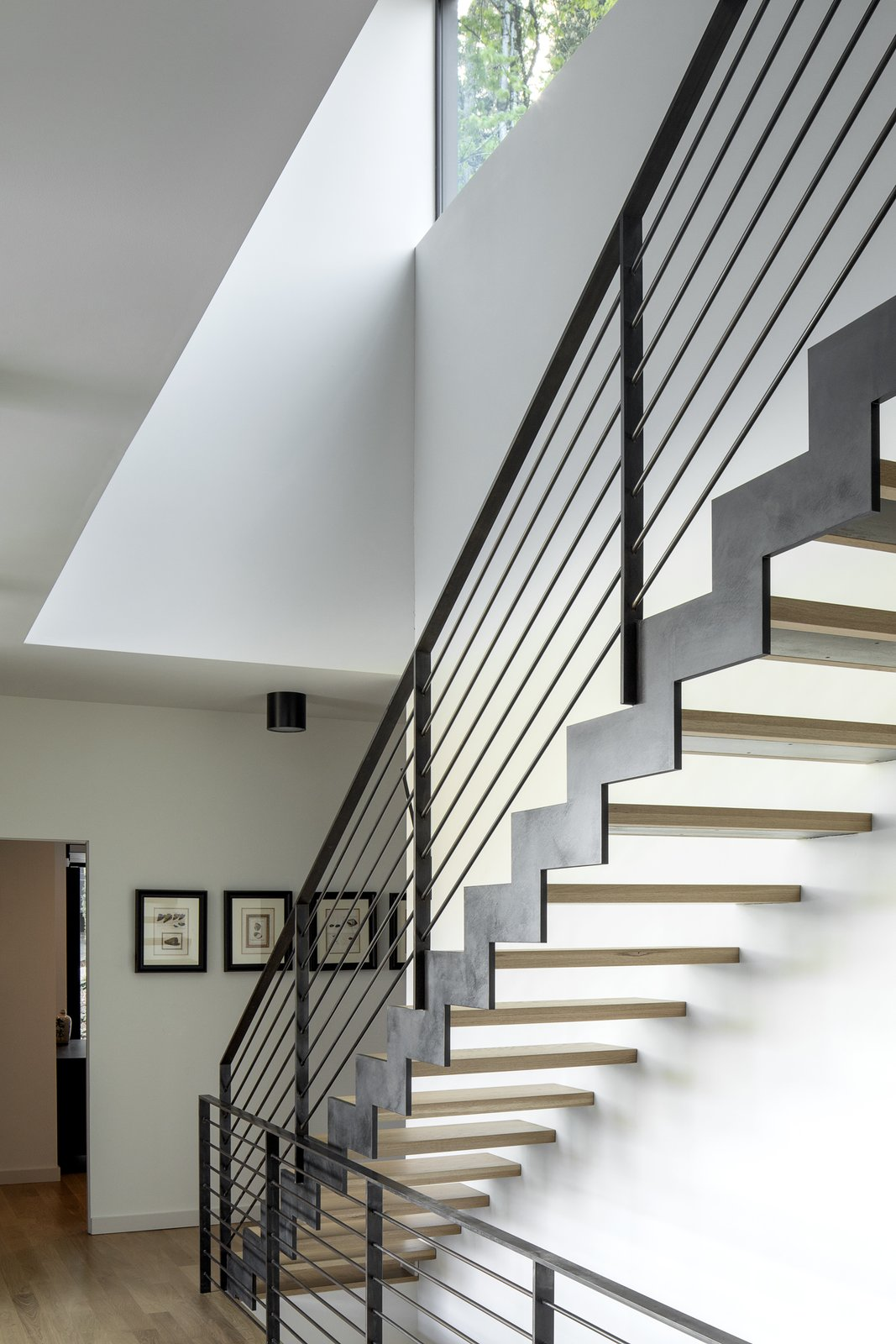 Steel stair leading to the 3rd floor master suite.  Riverwood