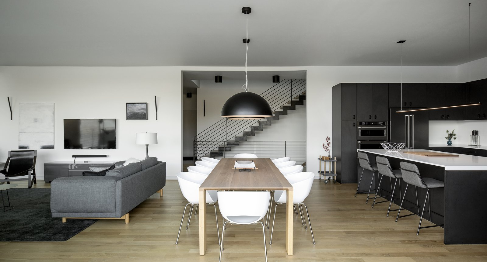 Dining Room with steel stair beyond.  Riverwood