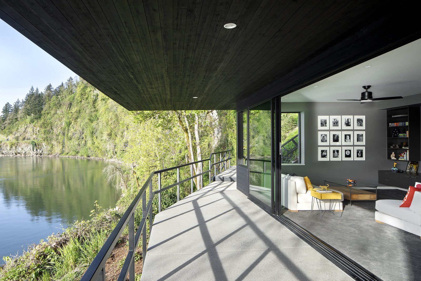 Family room on 1st floor opening up to the a small patio leading to the boat dock at the river.  Riverwood
