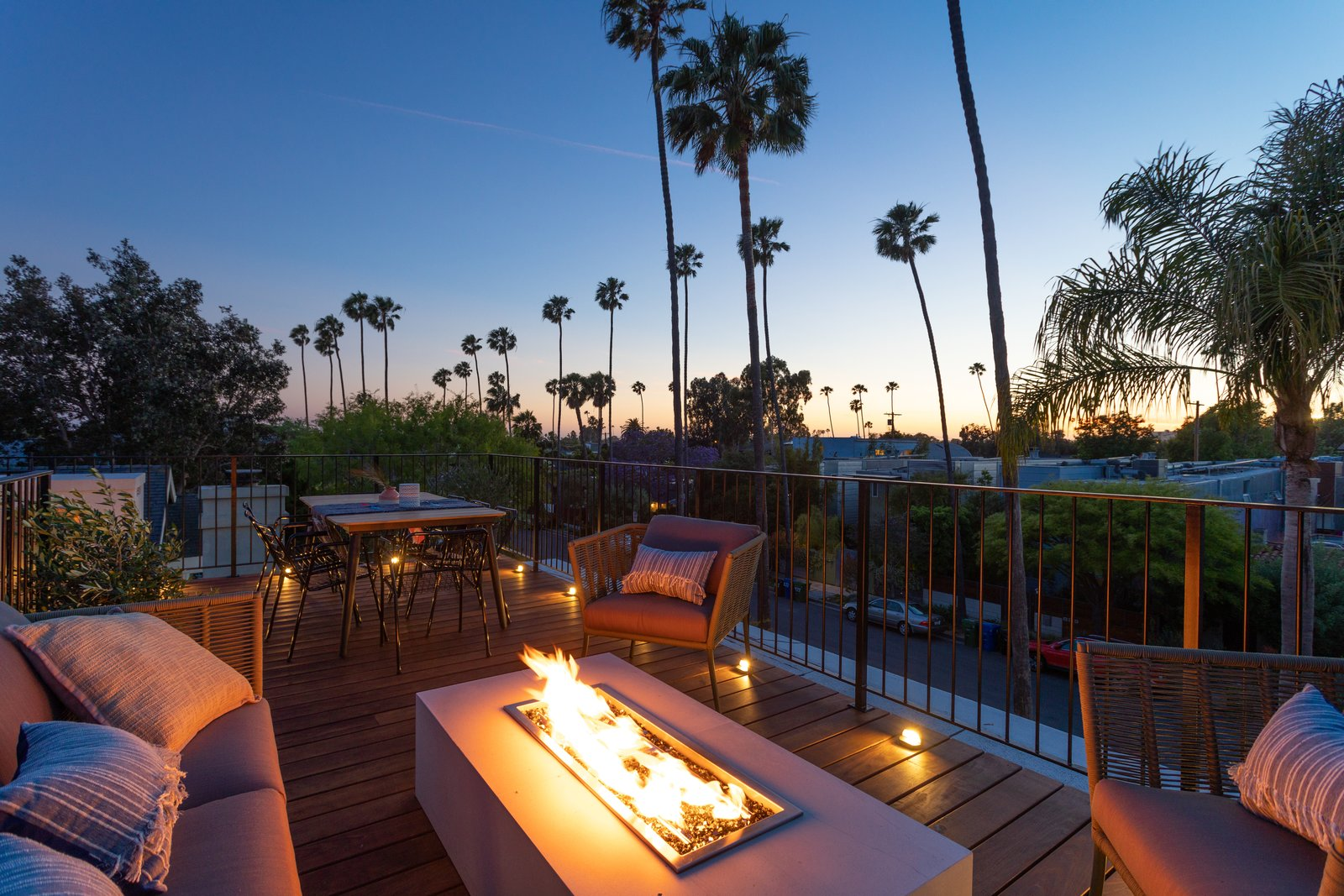 Outdoor and Rooftop Rooftop deck with fire pit with seating for outdoor entertaining.   Milwood Residence by Mayes Office