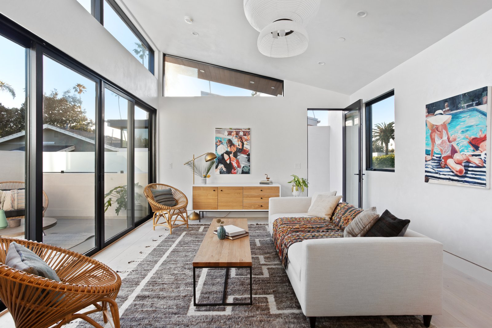Living Room, Console Tables, Rug Floor, Stools, Shelves, Recessed Lighting, Pendant Lighting, Lamps, and Sofa Second level detached accessory space gives added flexibility.  Milwood Residence by Mayes Office