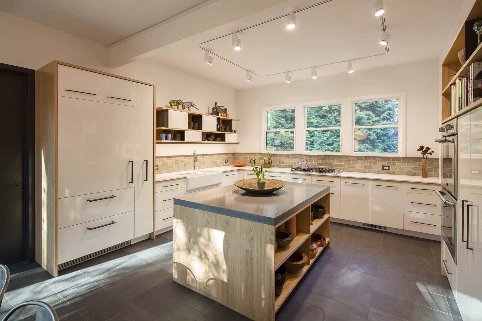 Kitchen, Concrete, White, Slate, Wood, Ceiling, Wall Oven, and Track New custom kitchen with high-gloss cabinets, custom plywood enclosures, concrete island counter top.  Best Kitchen Slate Wall Oven Photos from Professors Row
