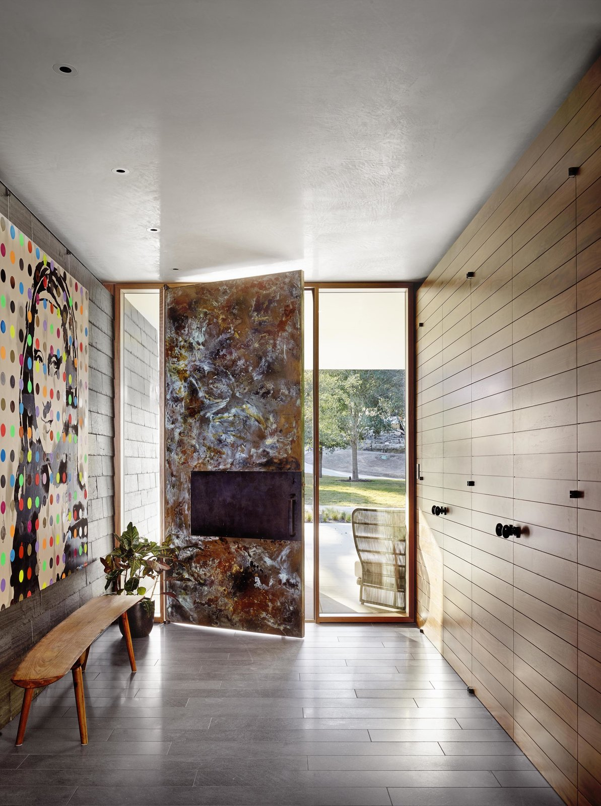 Hallway Artwork can also bring balance to a space, acting as a counterpoint to closets and doors, and introducing color schemes that play throughout the rest of the home.  LAKE AUSTIN HOUSE by Aamodt / Plumb