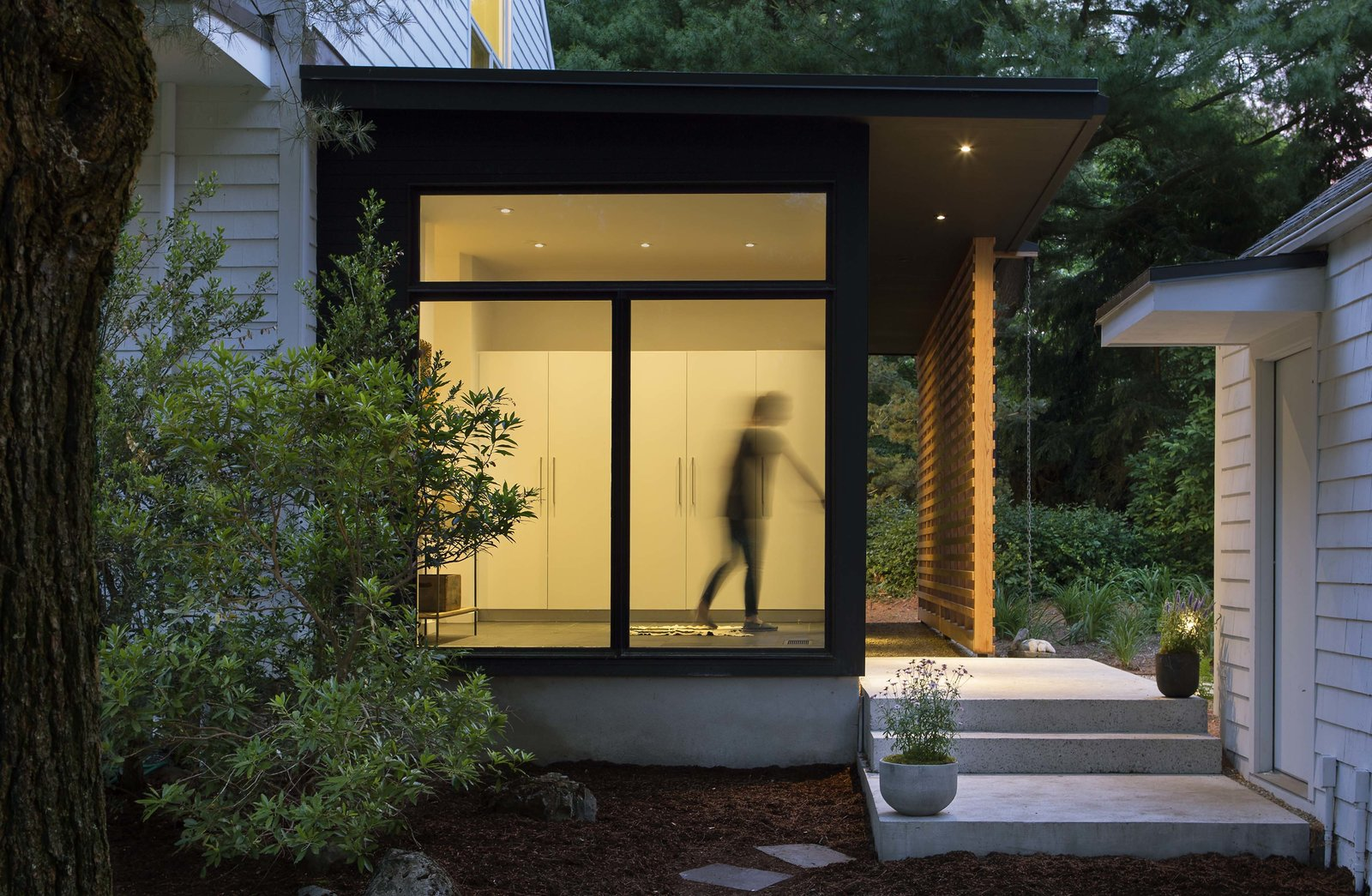 Exterior, House Building Type, and Wood Siding Material Floor to ceiling glass on the entry side and a fixed wood screen on the living side make a simple composition that is warm and inviting as well as being private.  Modern Barns by Aamodt / Plumb