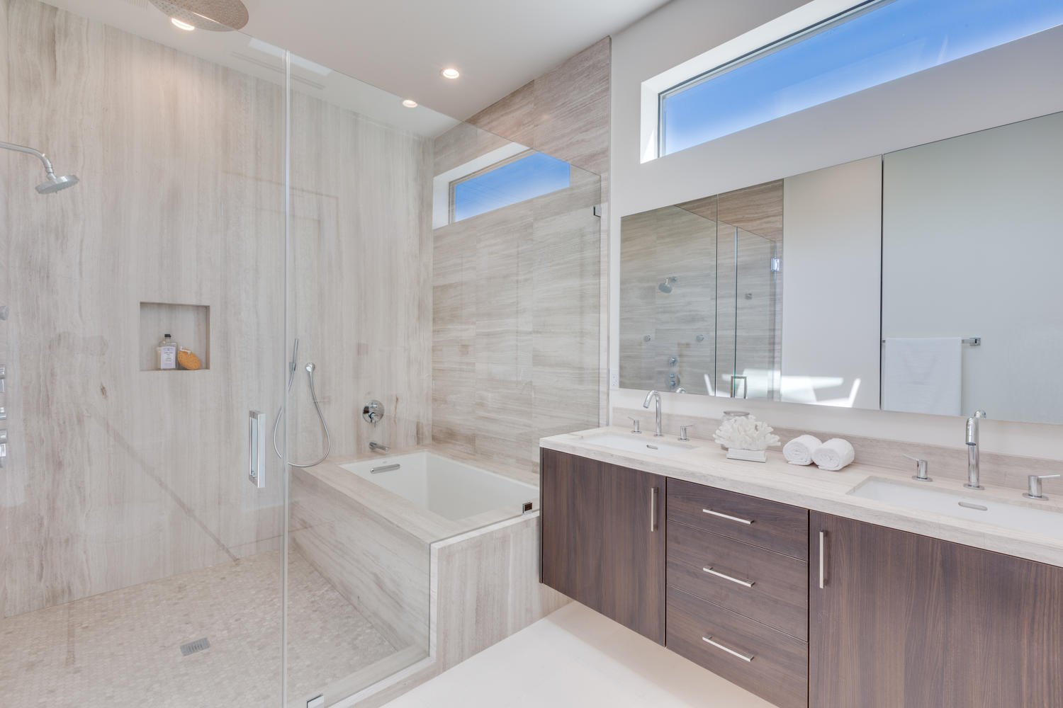 Bath Room, Drop In Sink, Limestone Floor, Marble Counter, Drop In Tub, Soaking Tub, Full Shower, Enclosed Shower, Ceiling Lighting, Recessed Lighting, Stone Tile Wall, and One Piece Toilet Master Bathroom  The Rosewood Residence