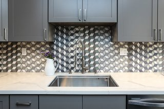 "Close up of ""Grey Dawn"" countertops, and Grohe faucet."