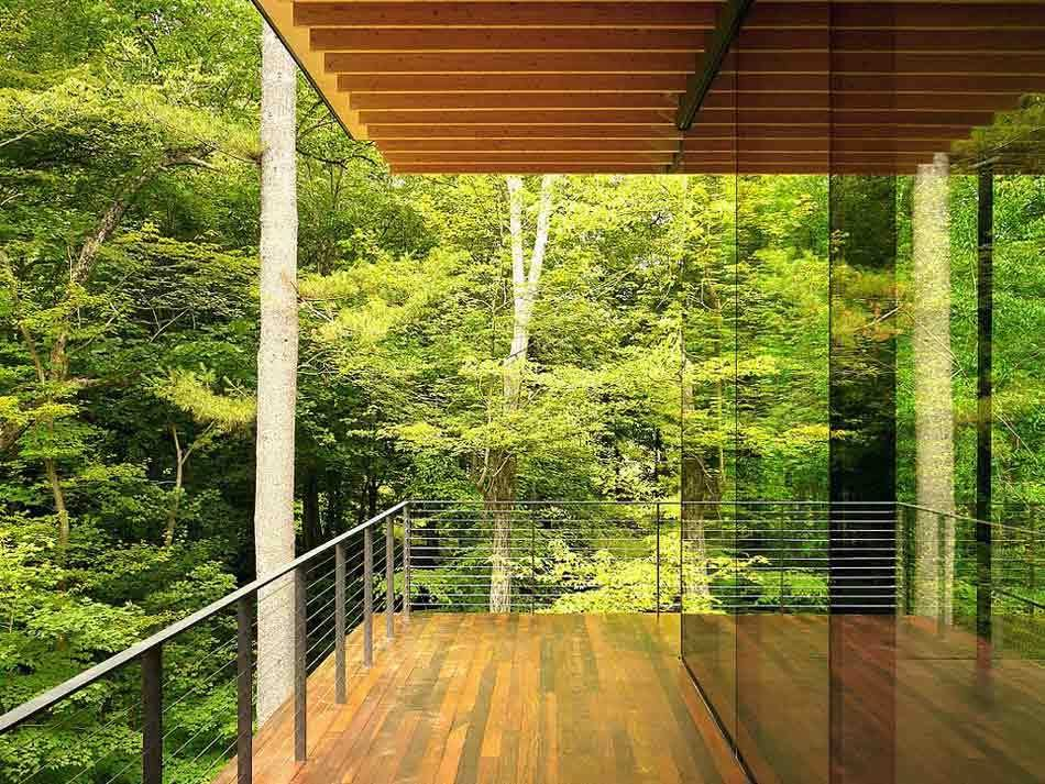 Outdoor, Horizontal, Woodland, Metal, Trees, Metal, Large, Wire, Wood, Decking, and Side Yard Architect Kengo Kuma designed a floating, transparent structure supported by very thin steel columns. Transparency was a common design goal for the entire project.  Outdoor Metal Side Yard Photos from 50 Jaw-Dropping Glass Houses That Shatter Expectations