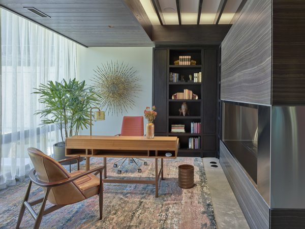 The office and library share an open bio-ethanol fuel fireplace by Ecosmart Fire.  The hearth is Walker Zanger Vintage Brown and stainless steel, the floors are polished concrete and the wood work is stained ash.