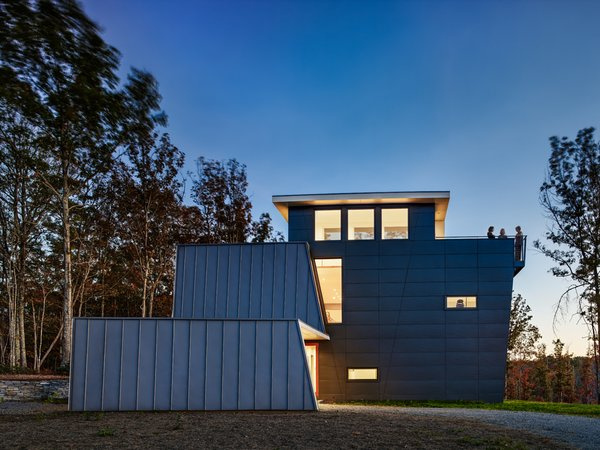 Beyond the functional requirements, the architects' concept for the roof form took on a dominant role in the building design: it folds up, around and down to shelter the house to the north and open up to views to the south. The standing seam metal roof allow for easy clipping of the solar panels.