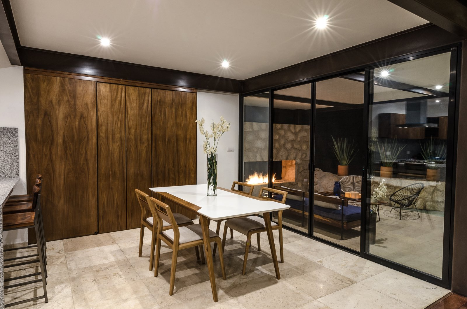 Dining Room, Two-Sided Fireplace, Table, Travertine Floor, Chair, Storage, and Ceiling Lighting Dinning and terrace  CQ12 by tescala