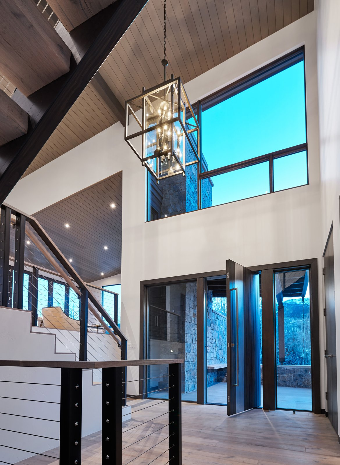 Staircase, Wood Tread, and Cable Railing The floor plan pays homage to the familiar split-level layout, utilizing the spatial and functional benefits, but with a luxurious and contemporary spin.   Terrace Drive by KA DesignWorks