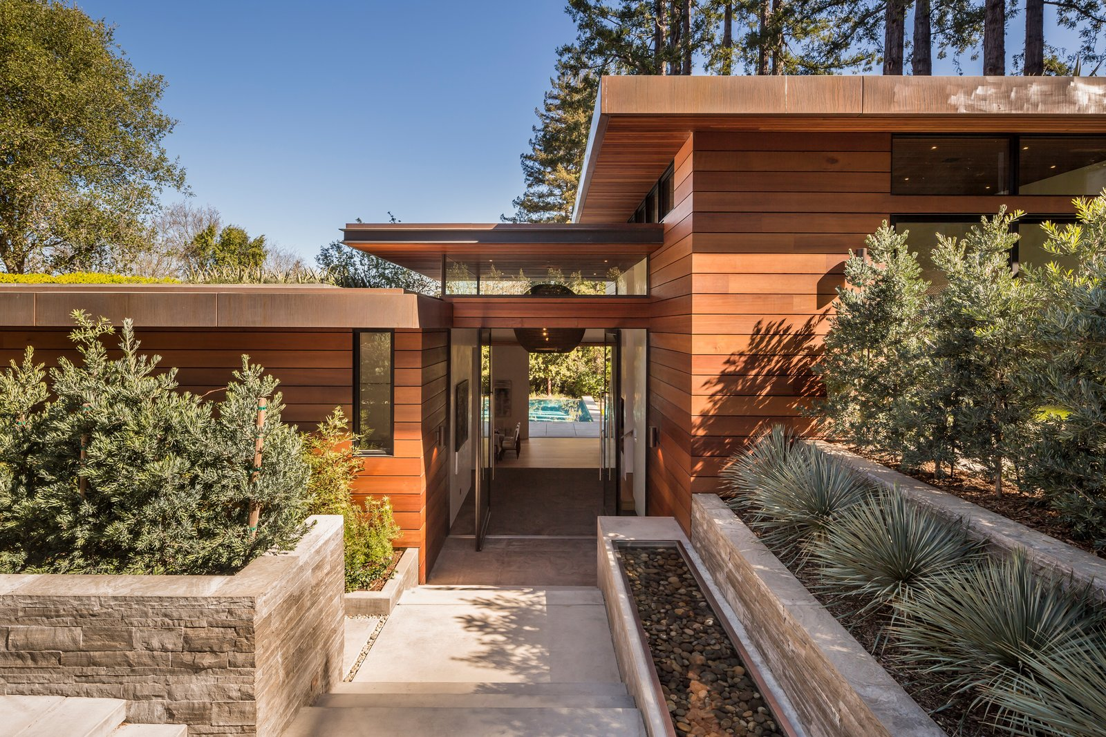 Exterior, House Building Type, Wood Siding Material, Flat RoofLine, and Green Roof Material Sleek staggered roof lines, copper clad with green roof tops  Ross Modern