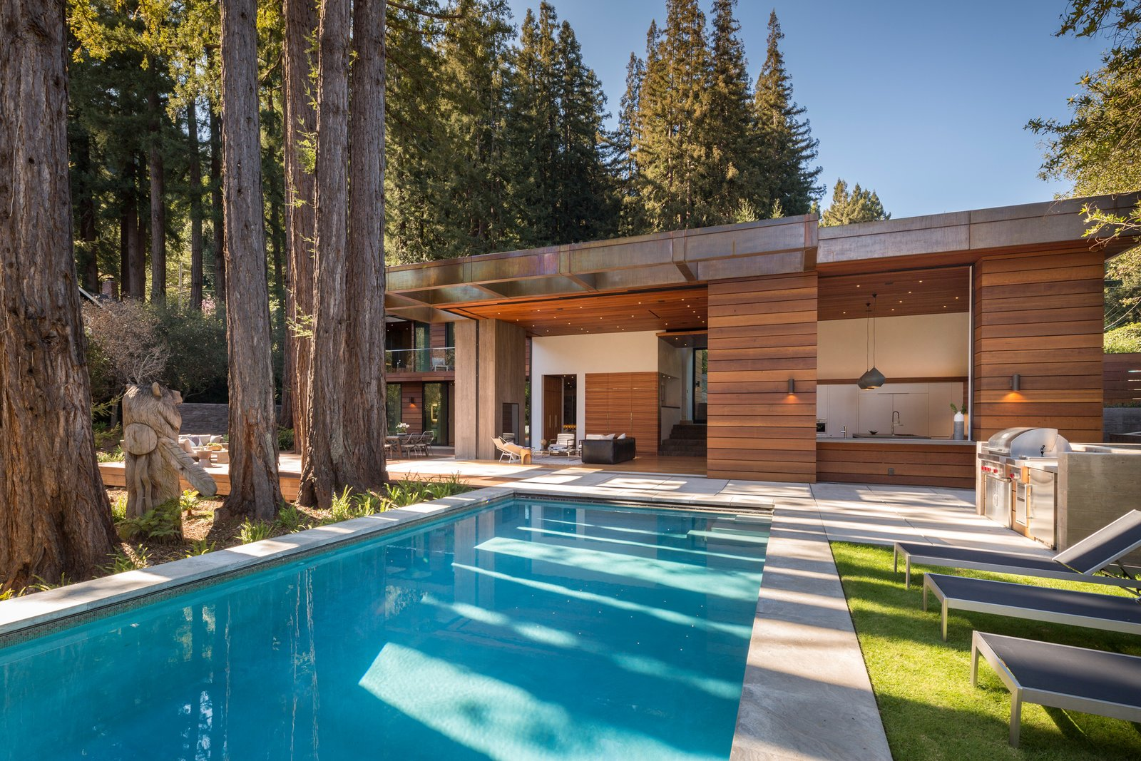 Indoor outdoor flow with disappearing walls of glass  Ross Modern