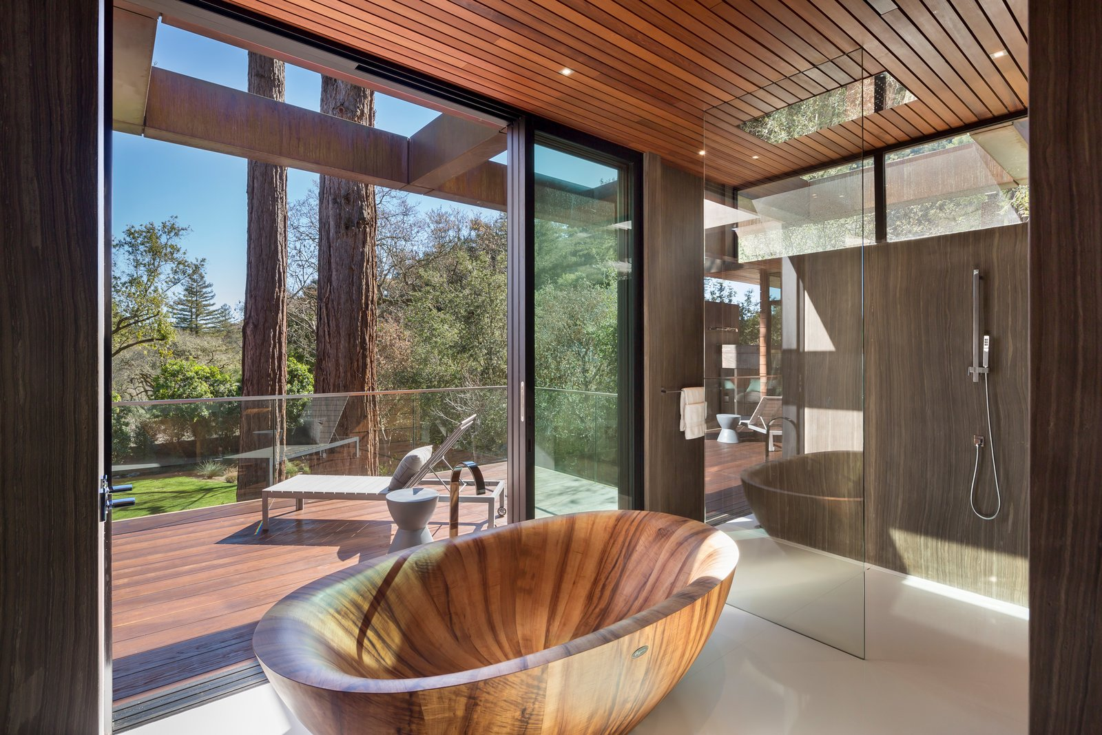 Master batheroom walls are of full slab stone.  This Koa tub was hand made in Europe  Ross Modern