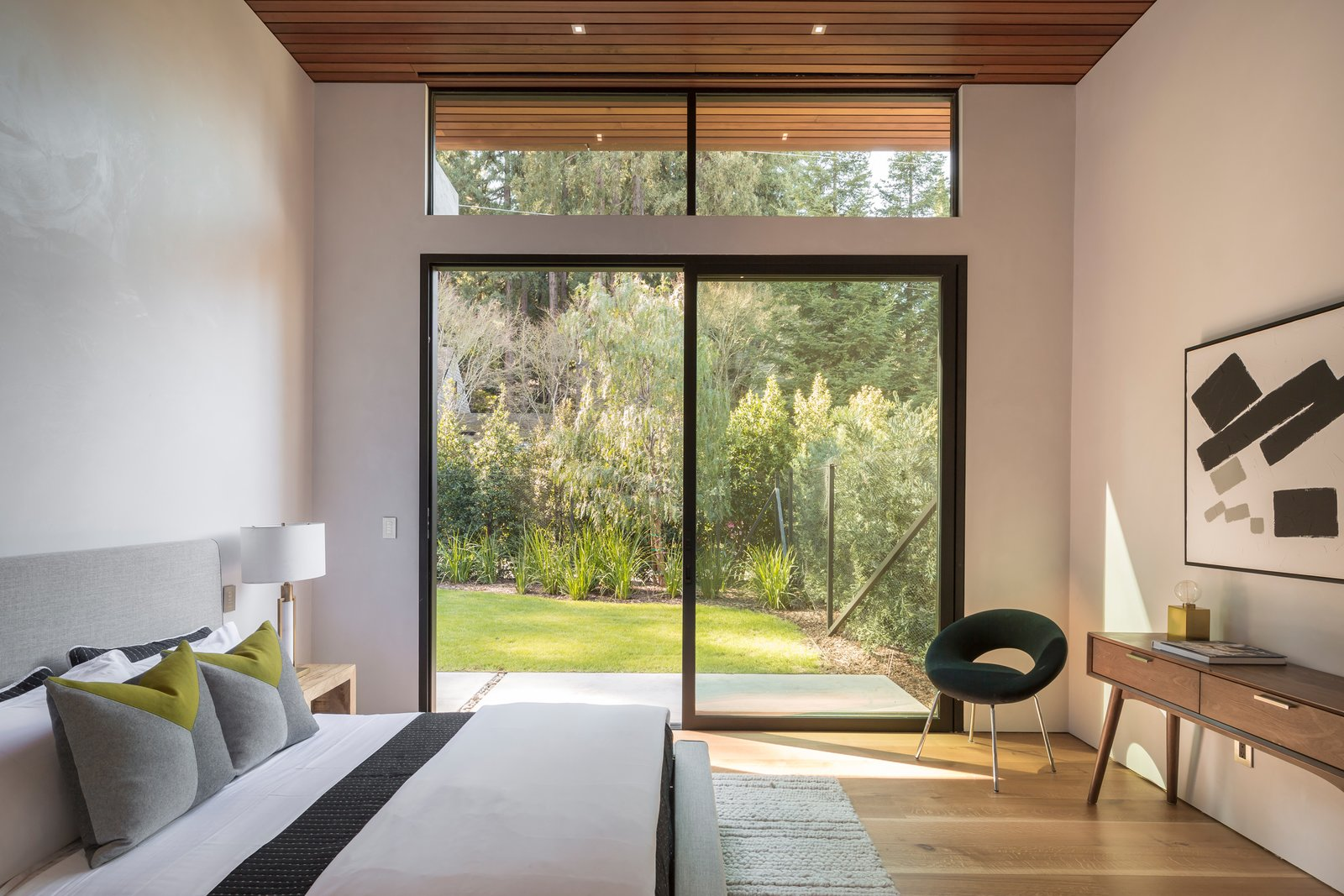 One of three Upper Level Bedrooms seamlessly flows out to private front yard   Ross Modern