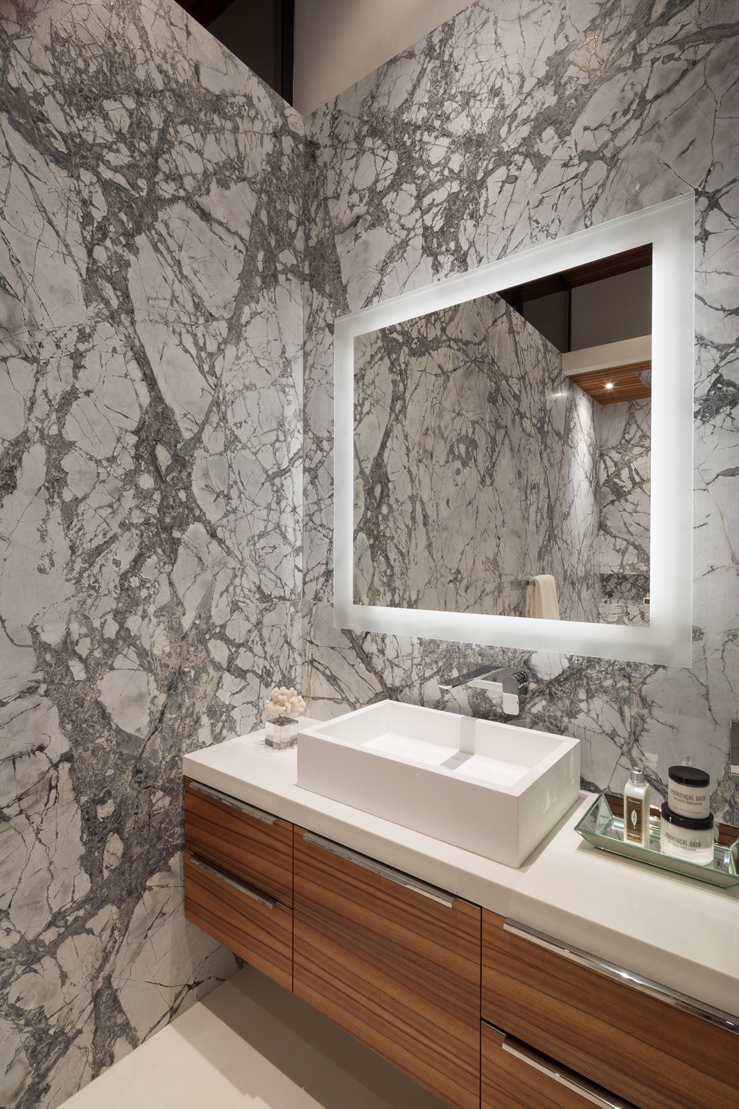One of the three upper  level bathrooms. Notice the incredible honed marble slabs and Koa cabinetry.  Ross Modern