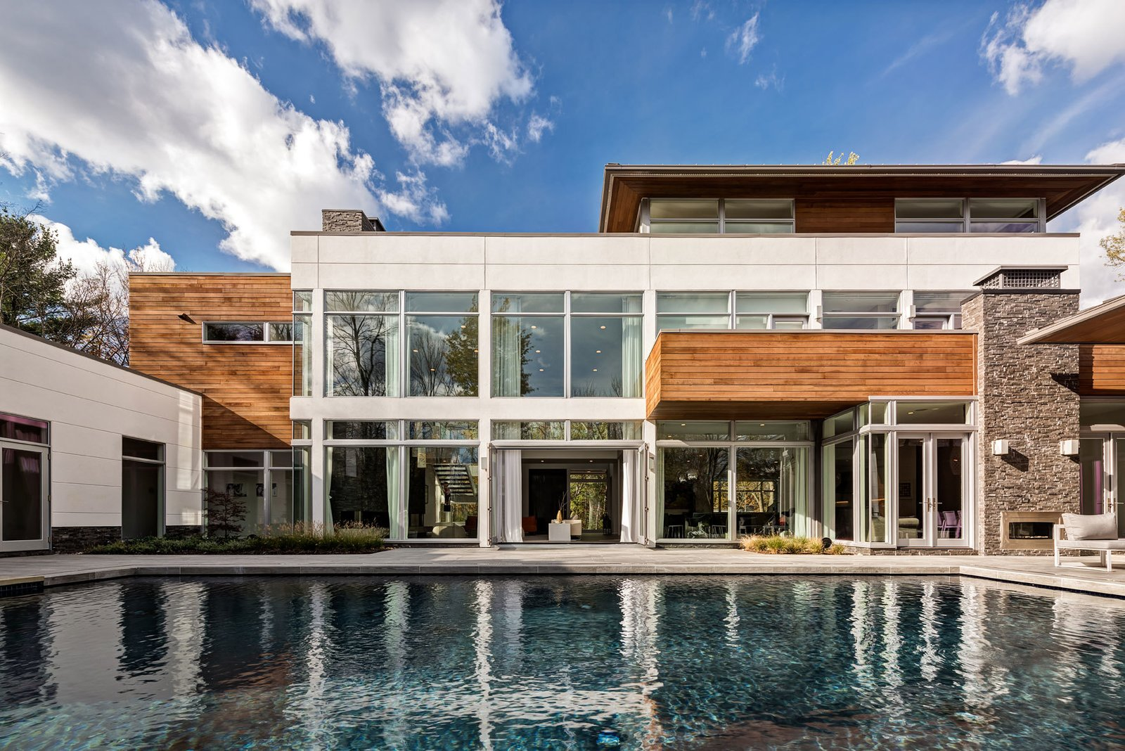 Outdoor, Swimming Pools, Tubs, Shower, Grass, Large Patio, Porch, Deck, and Back Yard The large folding and French patio doors of Bentleyville Residence by Dimit Architects allows the inhabitants to enjoy a strong connection between the indoor and outdoor spaces of their home.  Photo 5 of 5 in Top 5 Homes of the Week With Eye-Popping Pools from Bentleyville Residence