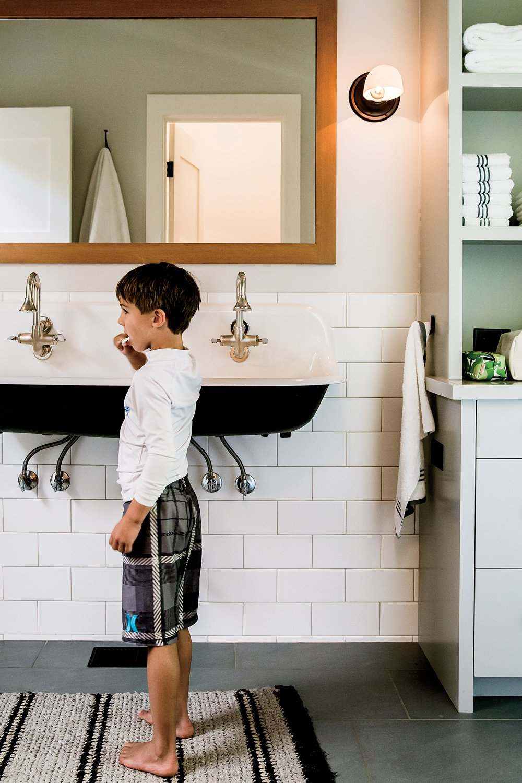Bath Room, Wall Mount Sink, Concrete Floor, Wall Lighting, and Subway Tile Wall Lake Chelan  Lake Chelan by Hoedemaker Pfeiffer