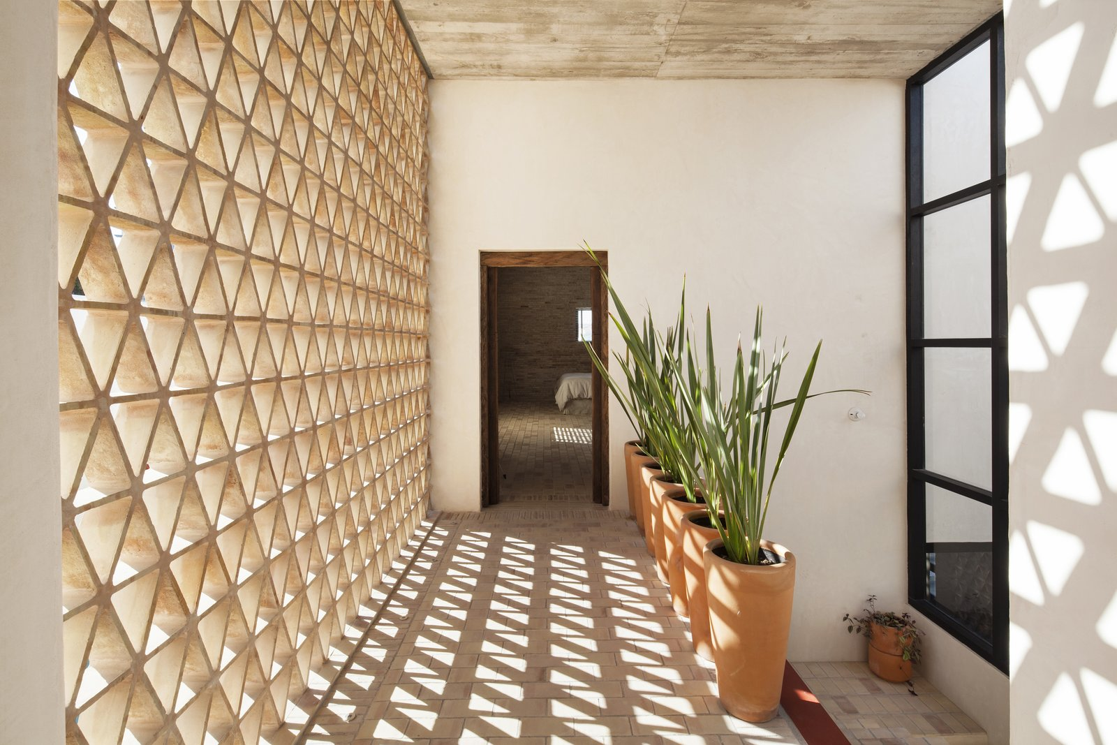 Hallway and Brick Floor Aisle.  Casa Iguana by OBRA BLANCA