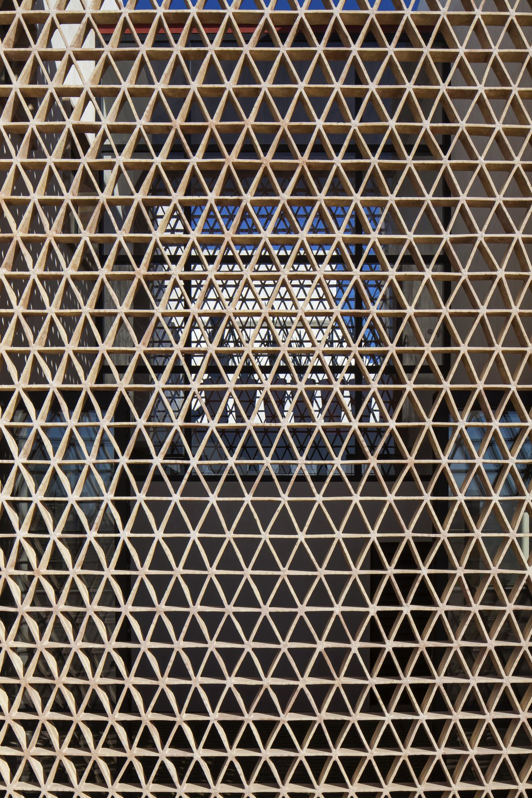 Outdoor and Vertical Fences, Wall Lattice wall made out of thin clay bricks.   Casa Iguana by OBRA BLANCA